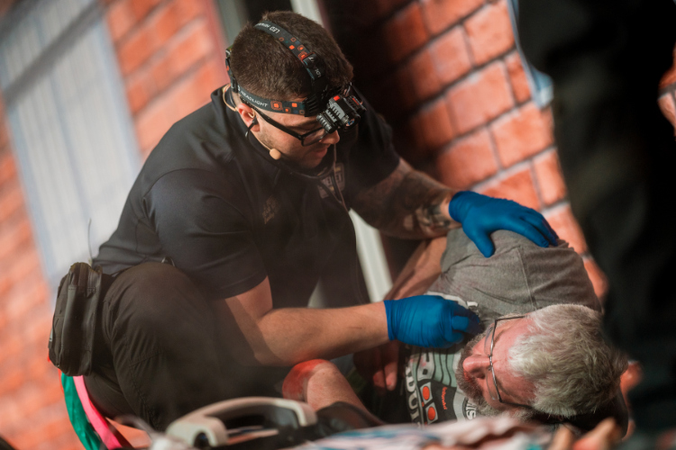 A paramedic helps a hurt patient during the JEMS Games.