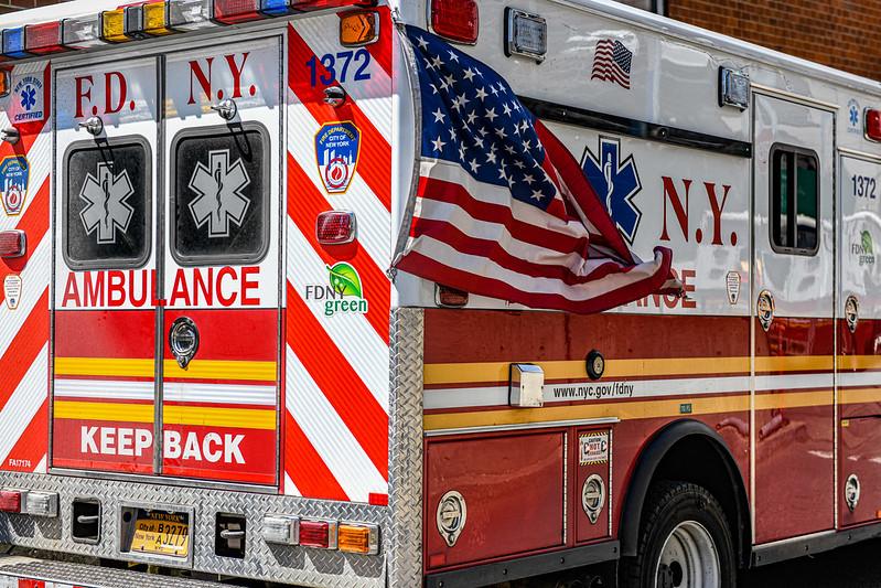 A flag flies on an FDNY ambulance.