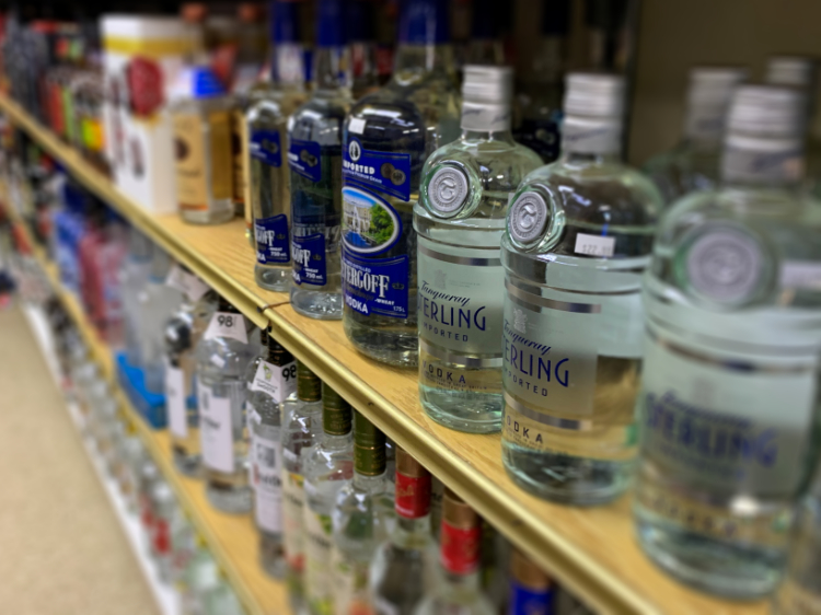 The photo shows bottles of alcohol lined up.