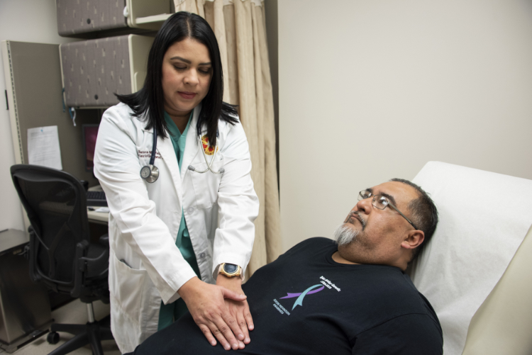 Selena Vela, bariatric/general surgery physician's assistant, examines a pre-operation bariatric patient at Brooke Army Medical Center, Fort Sam Houston, Texas.
