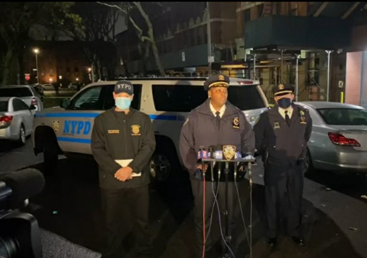 Police speaking at a press conference.