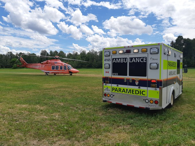 The photo shows a helicopter and an ambulance.