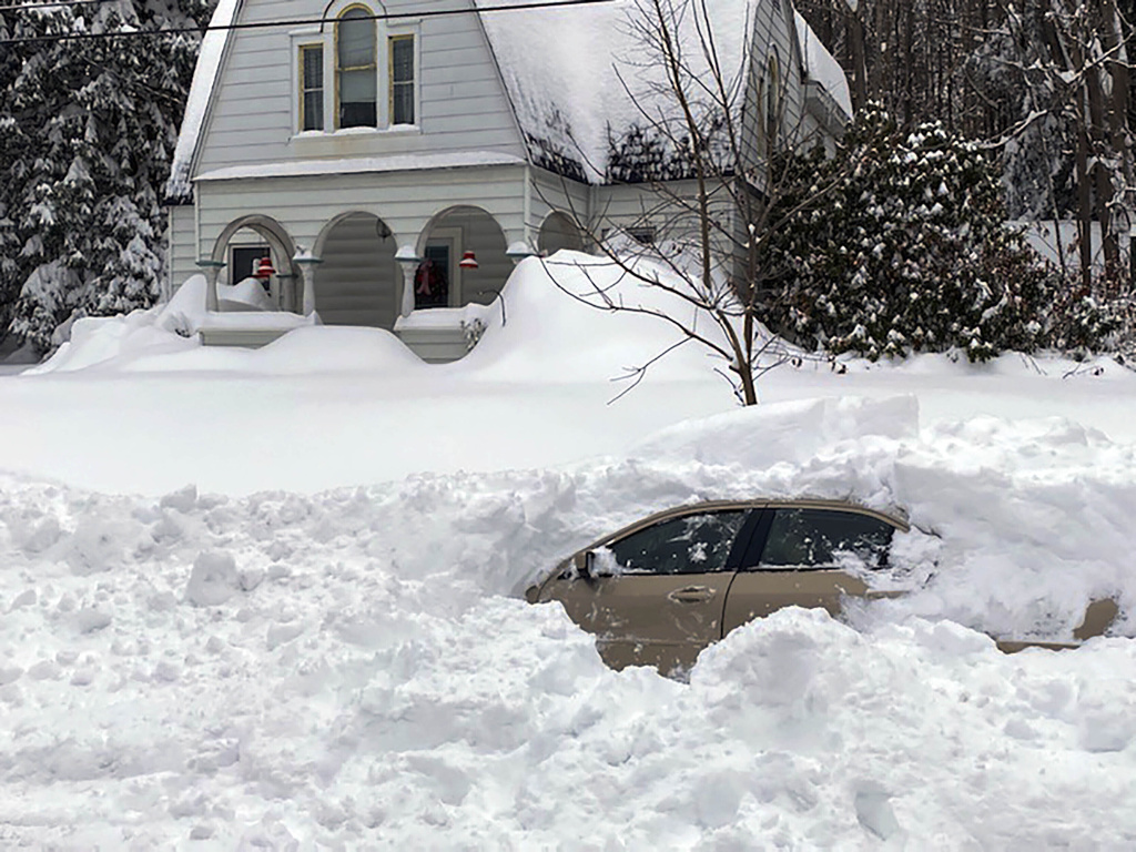 This photo, provided by the New York State Police, shows a car, in Owego, NY, from which a New York State Police sergeant rescued Kevin Kresen, 58, of Candor, NY.