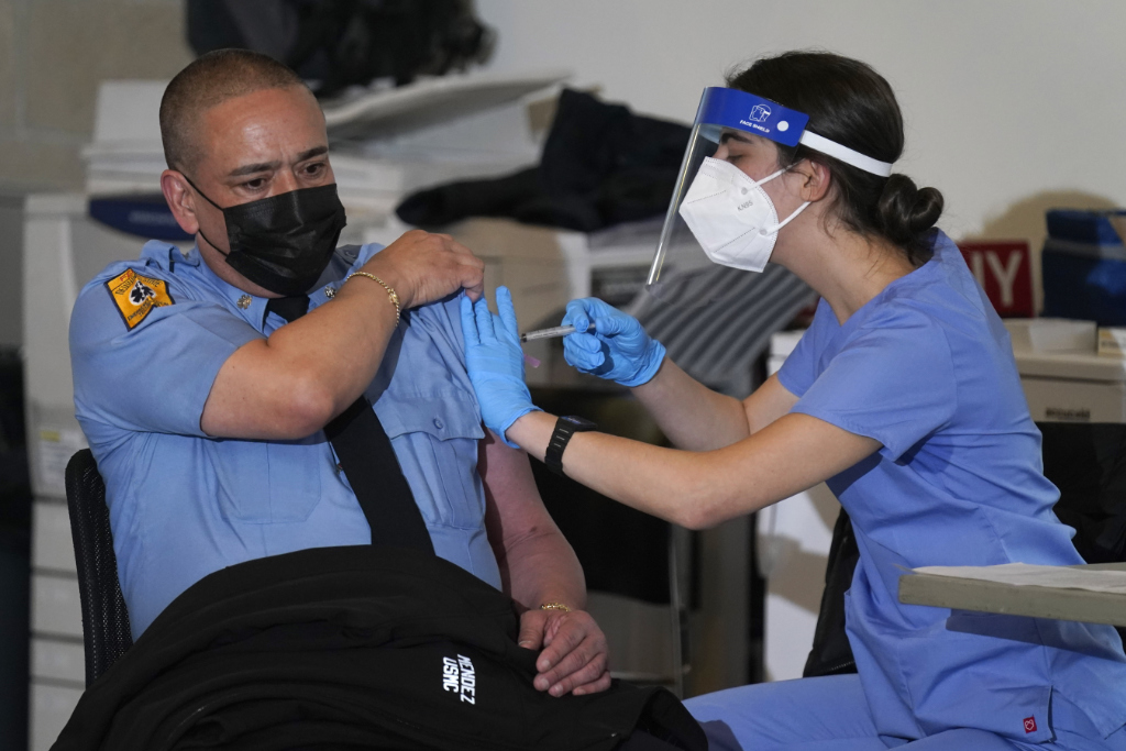New York City firefighter emergency medical services personnel are vaccinated against COVID-19 at the FDNY Fire Academy in New York, Wednesday, Dec. 23, 2020.