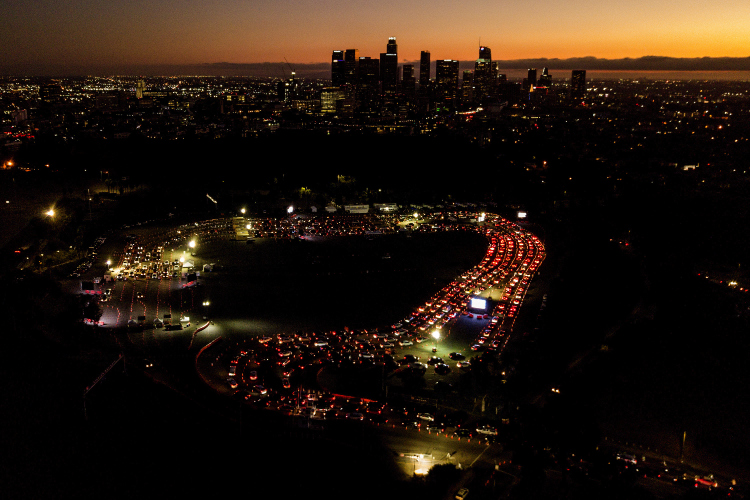 Motorists wait in long lines to take a coronavirus test in a parking lot at Dodger Stadium in Los Angeles.