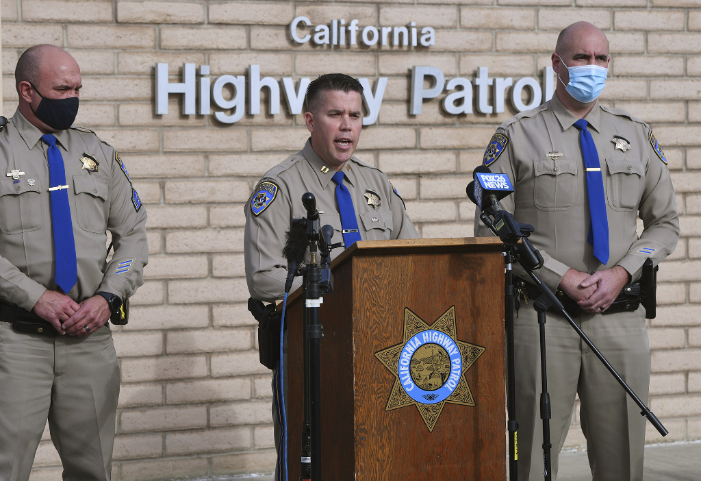 California Highway Patrol Captain Kevin Clays, center, updates the media about Friday's fatal crash on Highway 33 on Saturday, Jan. 2, 2021 in Coalinga, Calif.
