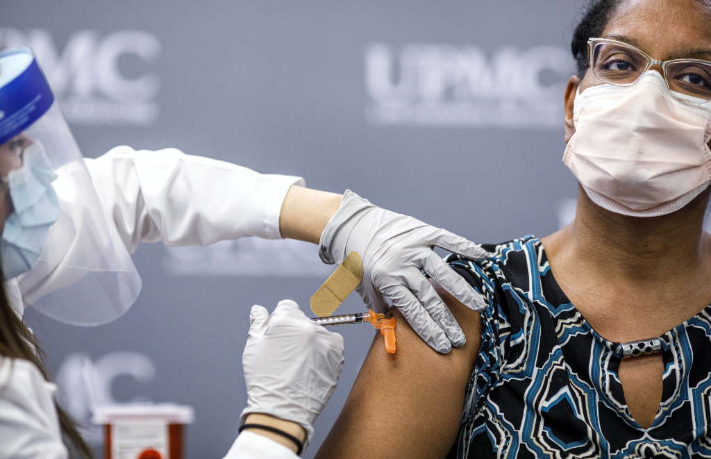 Jill Johnson adminsters the Pfizer COVID-19 vaccine to Sharee Livingston, an OB-GYN with UPMC Lititz.
