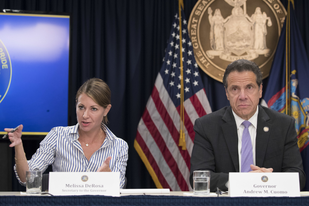 In this Sept. 14, 2018 file photo, Secretary to the Governor Melissa DeRosa, is joined by New York Gov. Andrew Cuomo as she speaks to reporters during a news conference.