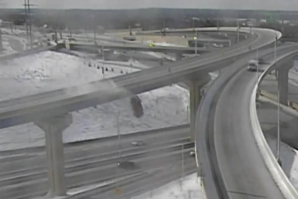 In this Saturday, Feb. 6, 2021 image from video made available by the Wisconsin Department of Transportation, a pickup truck falls off an elevated highway in Milwaukee.