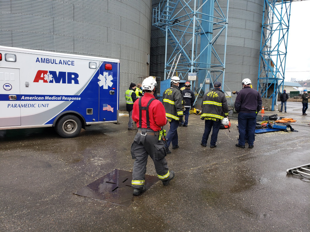 Emergency responders rescued a man after he fell about 19 feet in a grain elevator at a local processing plant, according to the Spokane Valley Fire Department.