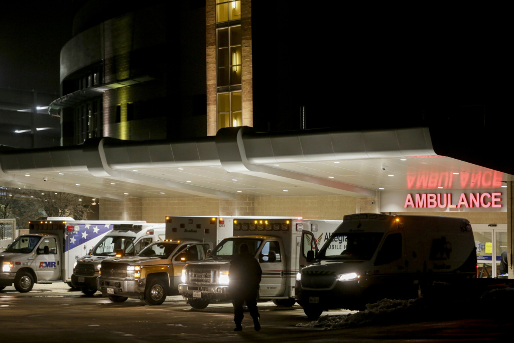 Ambulances line up outside of St. David's South Austin Medical Center in preparation to transport patients in Austin, Texas, on Wednesday, Feb. 17, 2021.