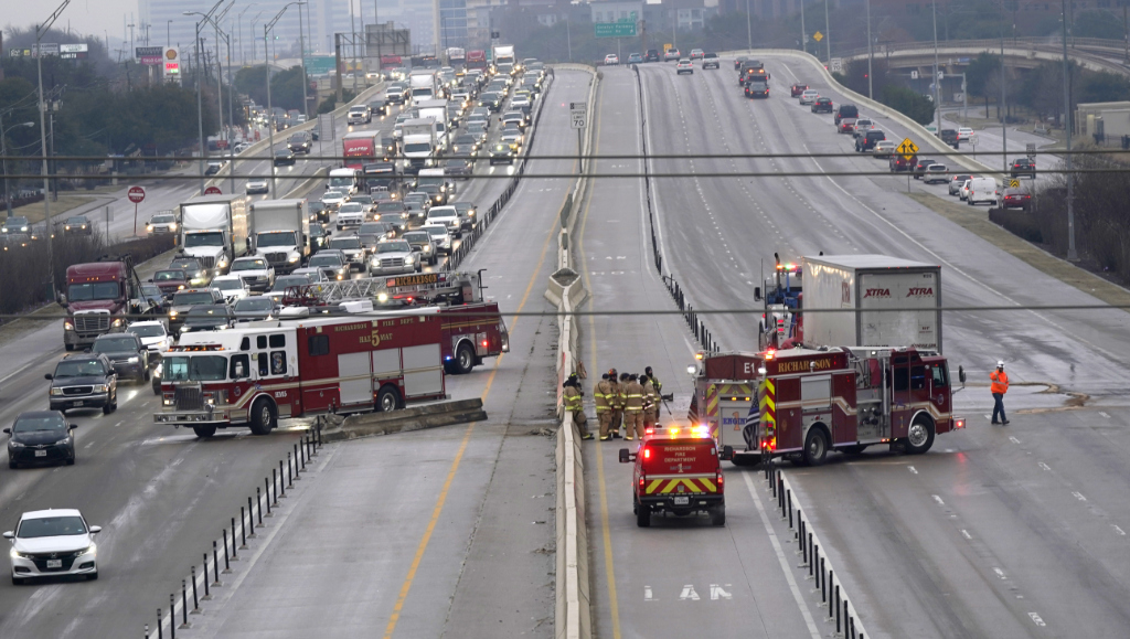 The highway sits closed as emergency crews finish cleaning following accidents caused by ice and low temperatures in Richardson, Texas.