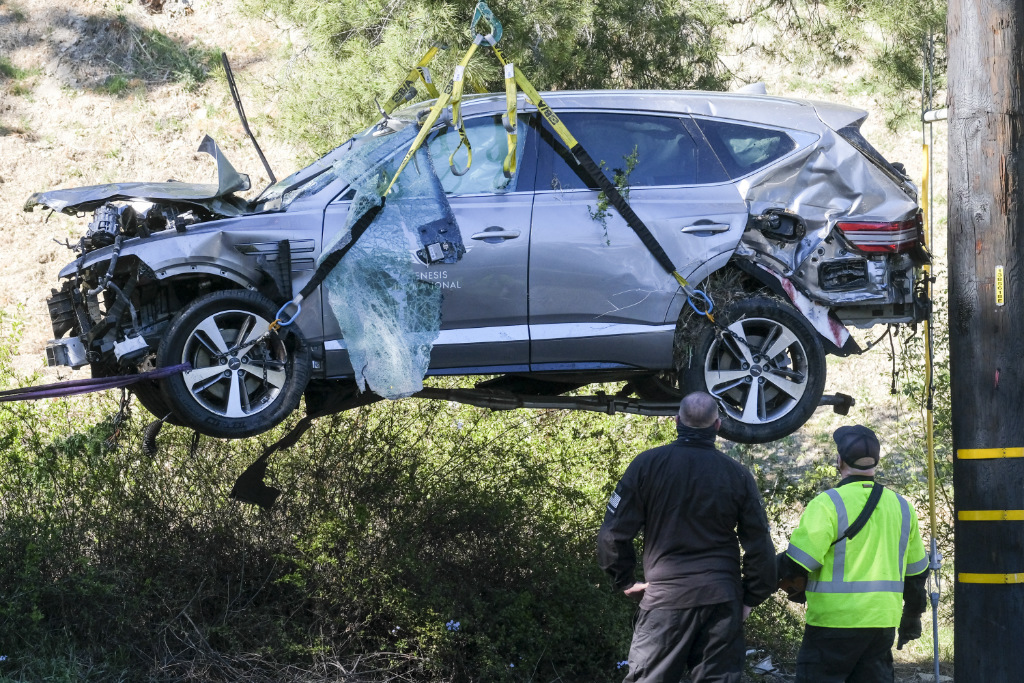A crane is used to lift a vehicle following a rollover accident involving golfer Tiger Woods, in the Rancho Palos Verdes suburb of Los Angeles.