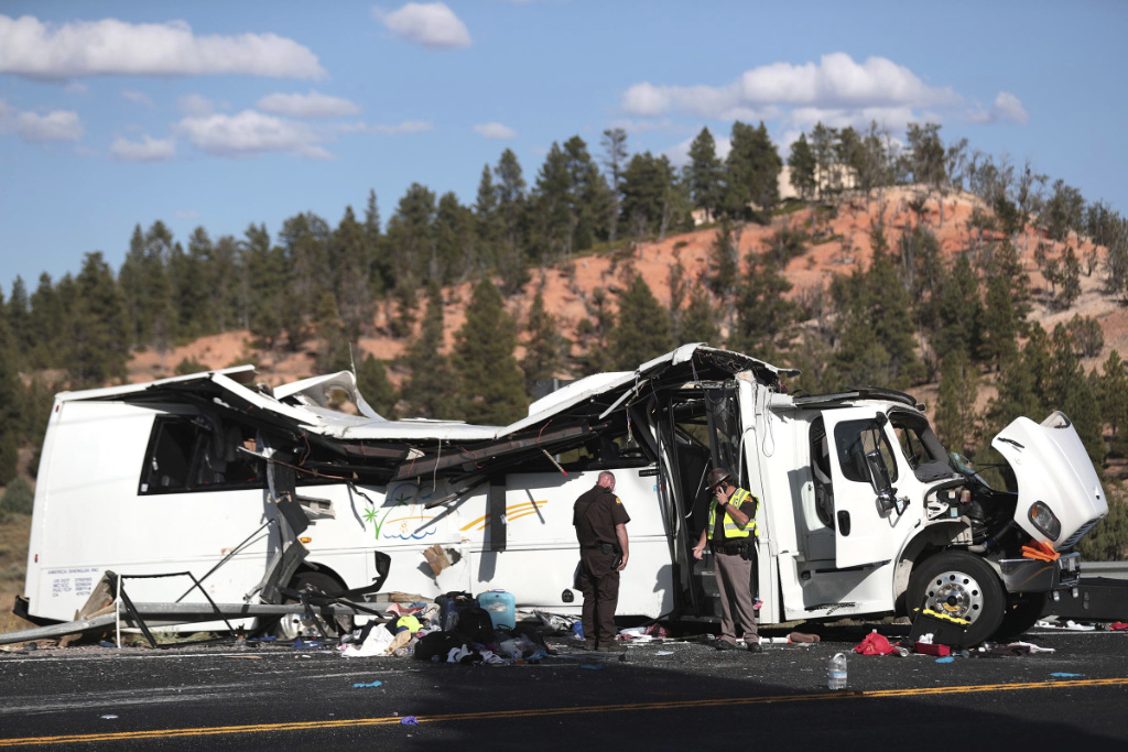 Authorities work the scene of a tour bus crash near Bryce Canyon National Park on Sept. 20, 2019, in Utah.