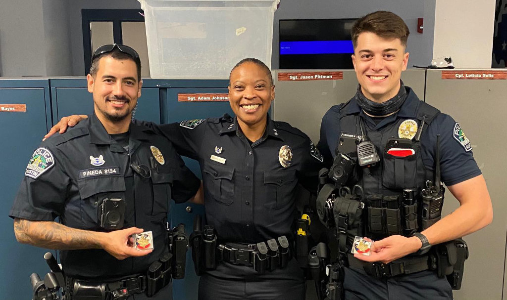 Assistant Chief Robin Henderson presented Officers Pineda and Carrera with a chief's coin in recognition of their heroic actions.