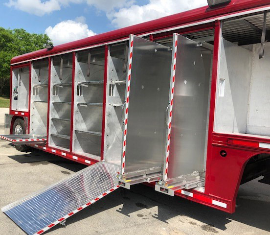 Refurbished trailer features loading ramps and slide-out panels for hanging hand tools.