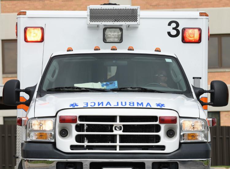 The photo shows a white ambulance.
