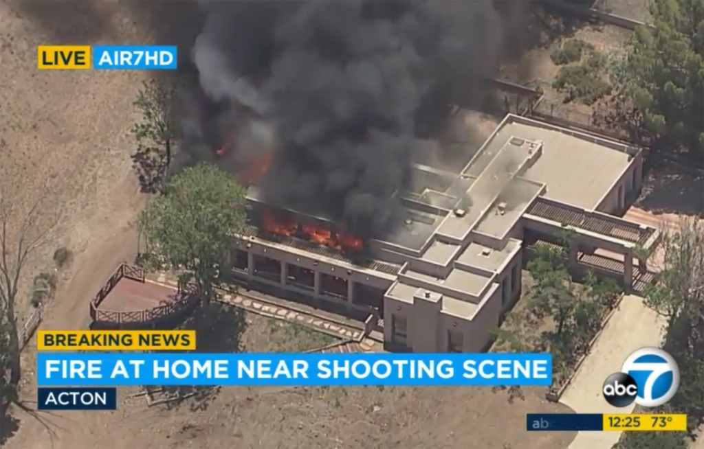 This aerial image taken from video provided by KABC-TV shows fire coming from a house, in Acton, Calif., Tuesday, June 1, 2021, where a suspect fled to after a shooting at a fire station.