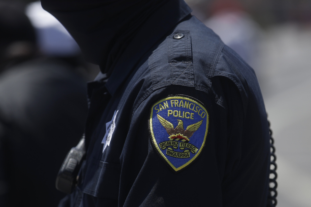 A San Francisco Police Department patch is shown on an officer's uniform in San Francisco.