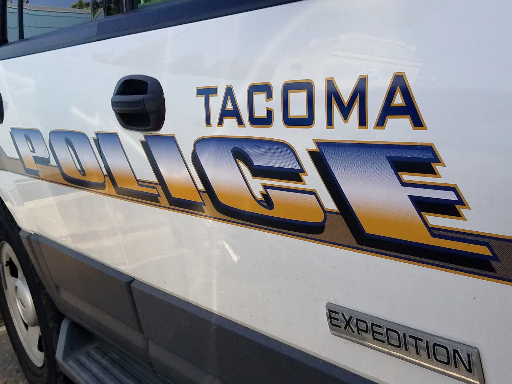 The side of a Tacoma Police Department squad car.